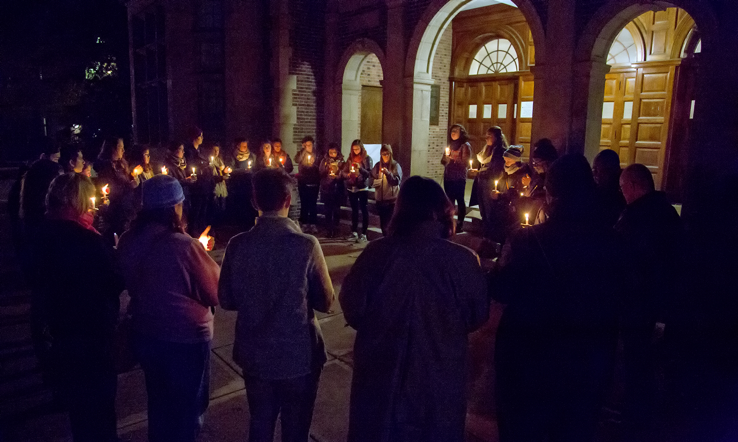Students gather outside of Coxe Hall for the Candlelight Vigil during Take Back the Night on Tuesday.