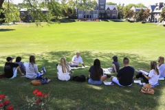 """Professor of Education Charlie Temple brings his """"Comparative and International Education"""" class outside for a discussion of Amanda Ripley's book, """"The Smartest Kids in the World: And How They Got That Way."""""""