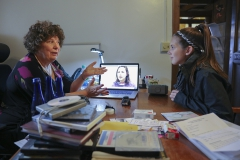 """Professor of Media and Society Linda Robertson meets with Gabriella Goodwin '19, a student in her """"Introduction to Social Documentary"""" class. Goodwin created a three-minute segment that highlights the impact that music has on learning."""