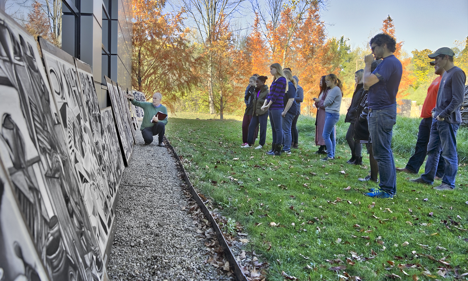 Professor of Art and Architecture Nick Ruth gives feedback to students in âColor and Compositionâ outside the Katherine D. Elliott '66 Studio Arts Center.