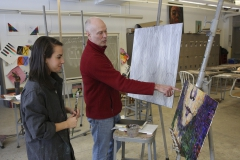 Nick Ruth works with Julie Kunzman '15 in the Elliott Art Center. Ruth is Kunzman's advisor and has been a student of his.