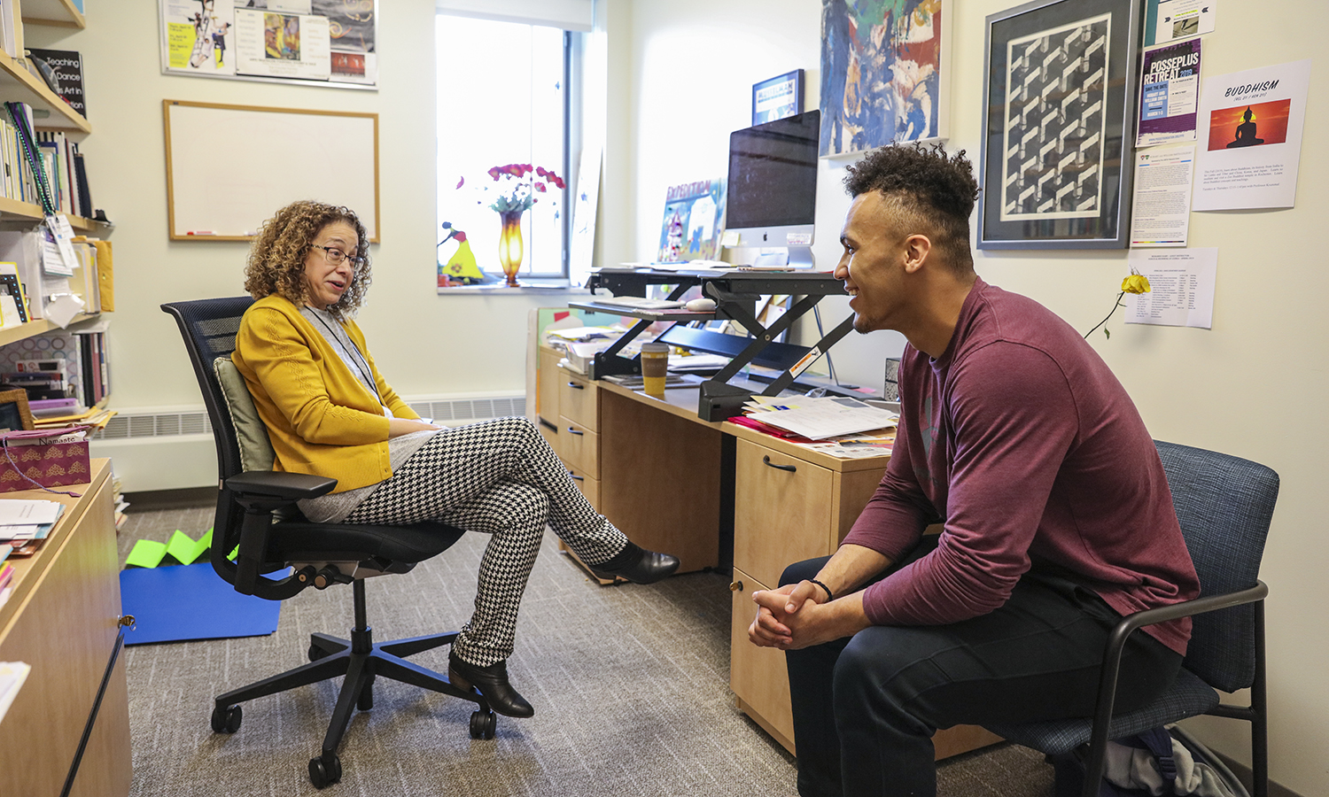 Dante Kimbrough '22 meets with his adviser, Professor of Dance Donna Davenport, in Davenport's office in the Gearan Center for the Performing Arts.