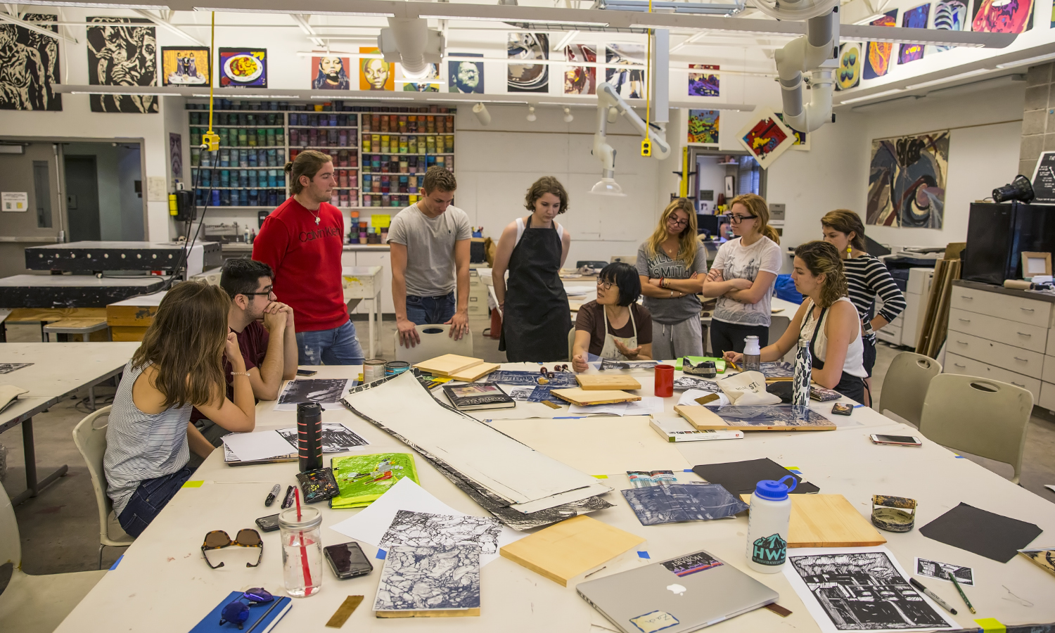 """Professor of Art and Architecture Phillia Yi speaks to students during """"Woodcut Printing"""" in the Katherine D. Elliott '66 Studio Arts Center."""