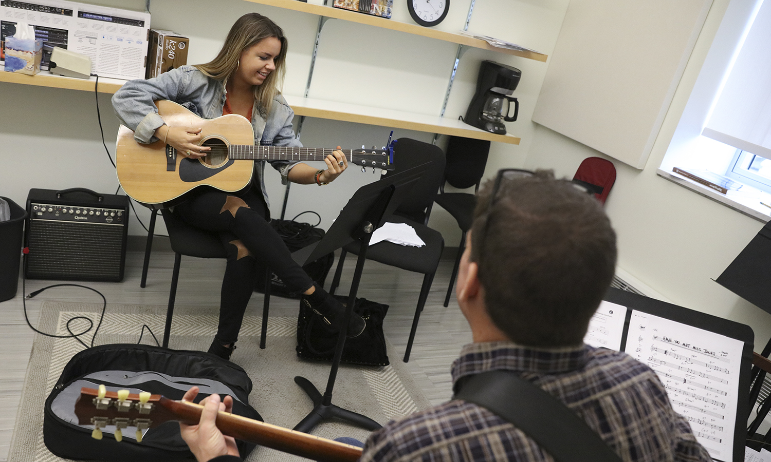 Liza Howard '18 has a lesson with Jazz Guitar Ensemble Director and Applied Instructor of Guitar Greg Wachala in the Gearan Center for the Performing Arts.