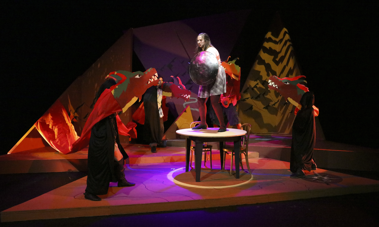 """Samantha Shaffner '17 wards off a group of dragons during practice for the HWS Theatre production of """"She Kills Monsters"""" in the McDonald Theatre."""