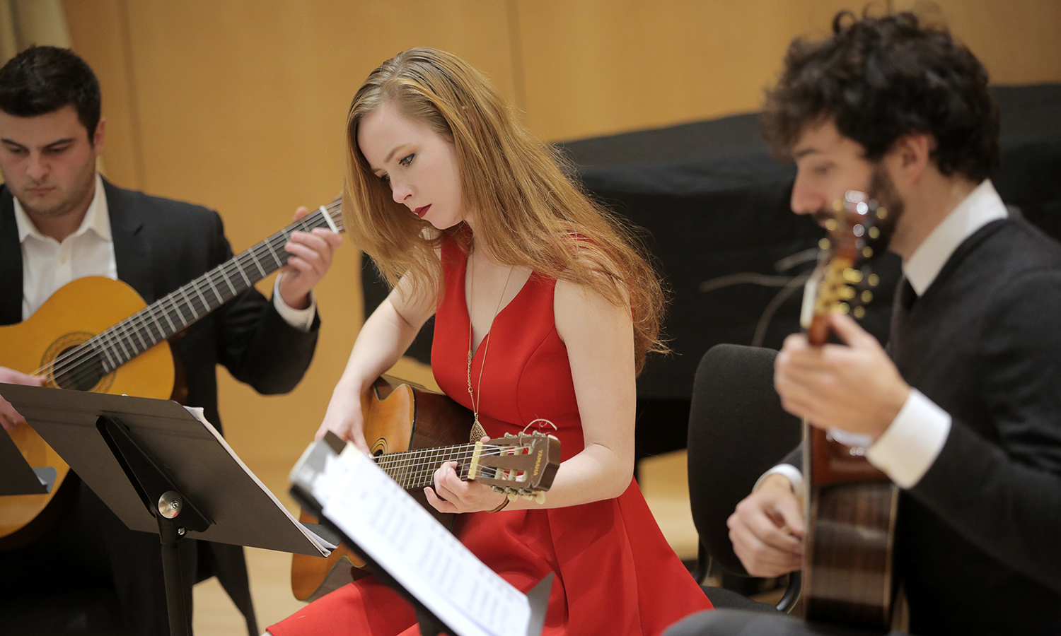 The Classical Guitar Ensemble, directed by Ben Ellis, performs in Froelich Hall.