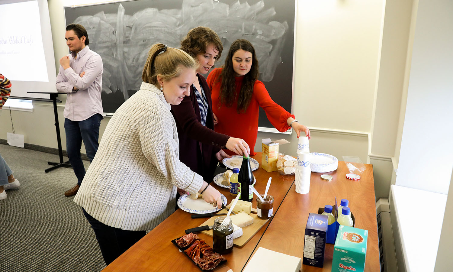 Guests build their own charcuterie board and sample French cheeses during the French Culture & Cuisine Global Café.