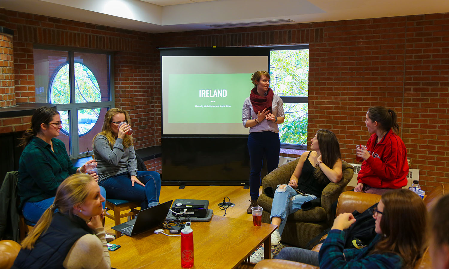 Predeparture and Reentry Programming Coordinator for the Center for Global Education Jennifer O'Neil welcomes students to a Global Cafe hosted by the CGE and returned study abroad students.