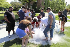 Led by Associate Professor of Chemistry Christine de Denus, students participating in the HWS Summer Science Academy look at the effects of dry ice.