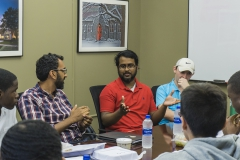 Albright Dwarka '21 and Hobart Dean Khuram Hussain talk during a lunch with a group of students.