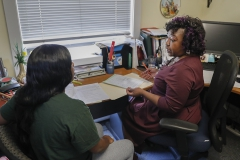 Assistant Director of Intercultural Affairs and Opportunity Programs Edith Wormley connects with a student in the Intercultural Affairs Center.