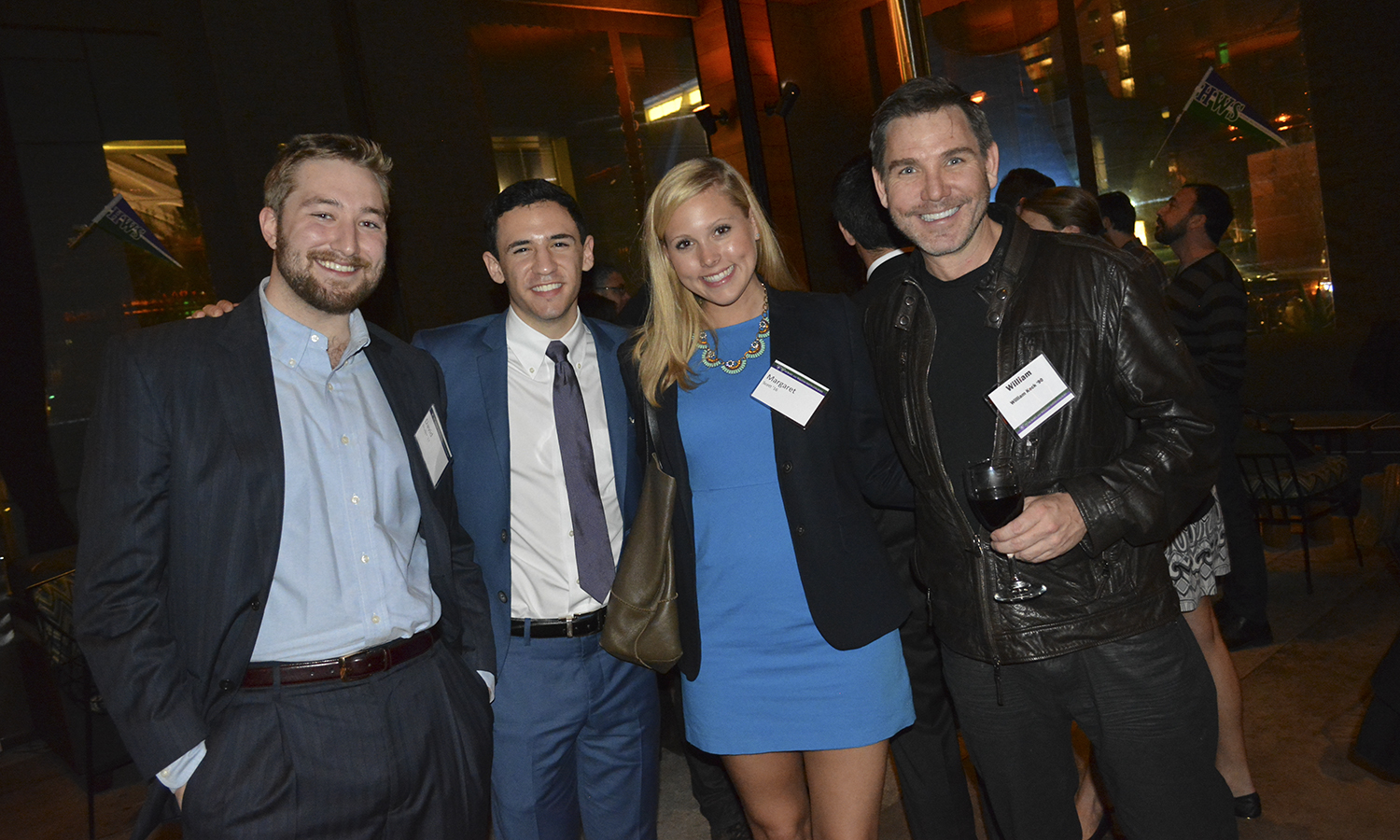 David Bruder '17, Michael DeRosa â16 , Margaret Scott '16 and Producer William Keck '90 pose for a photo during the New Year's Gathering in Los Angeles as part of the Behind the Scenes program.