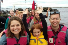 """Students on the HWS Chile trip tour Isla Damas by boat. The interdisciplinary course """"Stargazers and Dreamers in Chile: Literature and Astronomy"""" was co-led by Assistant Professor of Physics Leslie Hebb and Associate Professor of Spanish and Hispanic Studies May Farnsworth, who was accompanied by her daughter."""