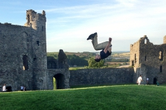 Richie Andes '19 does a flip to celebrate his first day in Wales in front of Llansteffan Castle, a 10th century Norman structure situated at the mouth of the Tywi River.
