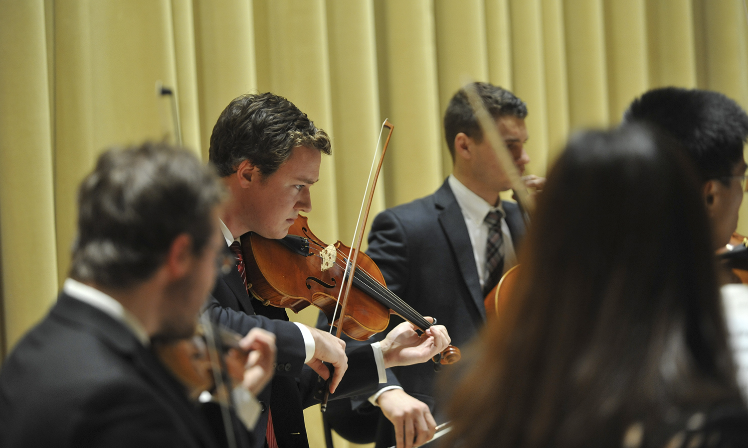 Dan Klementowski '17 plays the violin during the HWS String Ensemble concert in Froelich Hall of the Gearan Center for the Performing Arts on Wednesday.