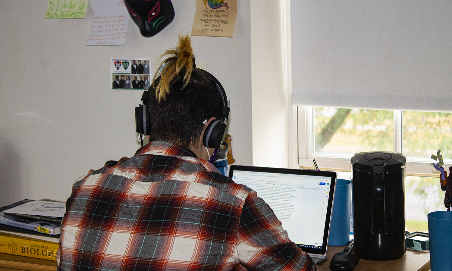 Declan Fox '23 listens to music while finishing up an assignment in his dorm room.