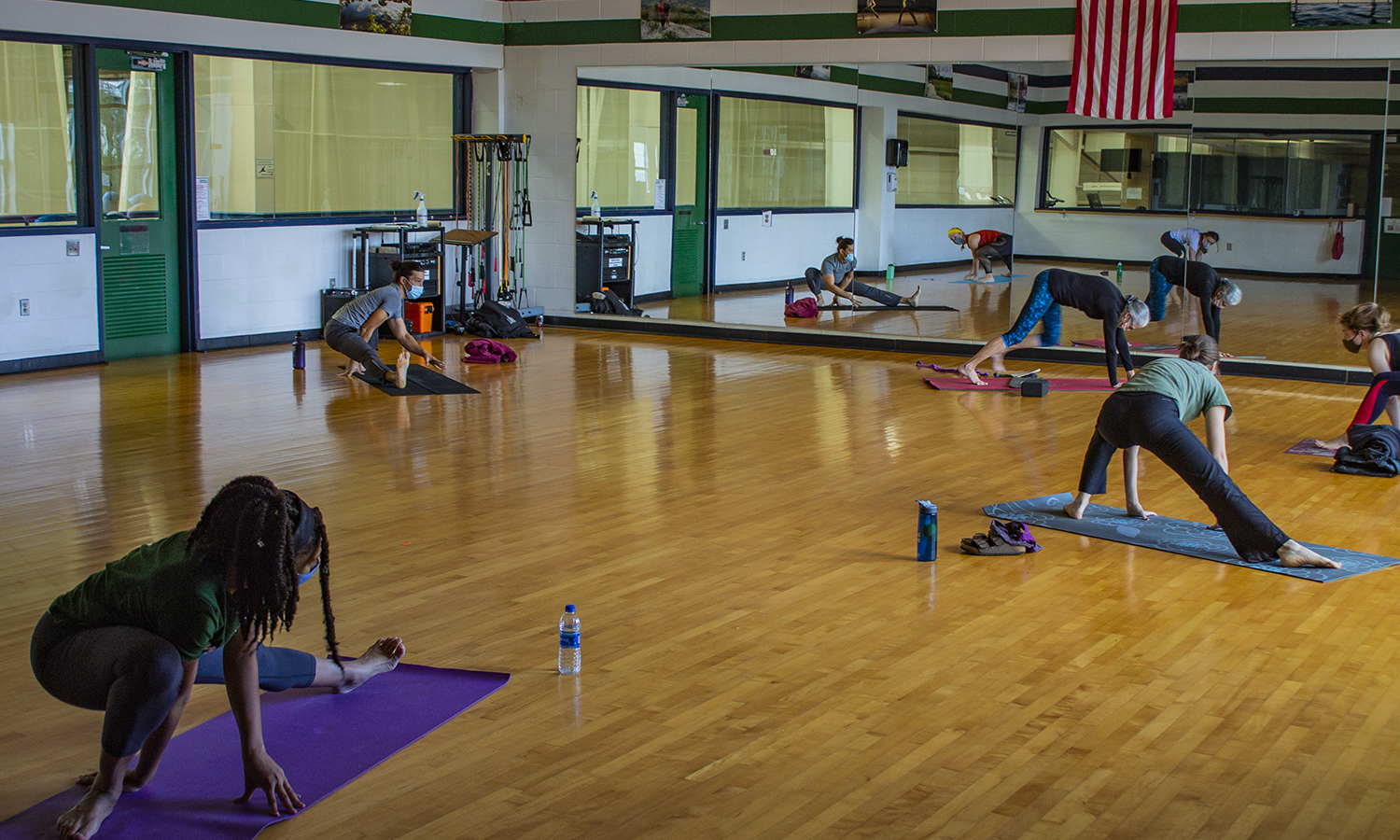 Sean Roulan leads a Saturday morning yoga class at the Bristol Field House.