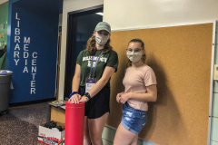 At North Street School, Ali Shaw '22 of Buffalo, N.Y., and Zoe Abrams '25 of Rome, N.Y. pause for photo before helping to decorate the halls during Day of Service.
