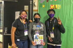 At North Street School in hall decorating boards (L-R) Kimberly Saavedra'25 of Los Angeles, Calif., Angela Hernandez'25 of Los Angeles, Calif., and Gio Arevalo '24 of Floral Park, N.Y.