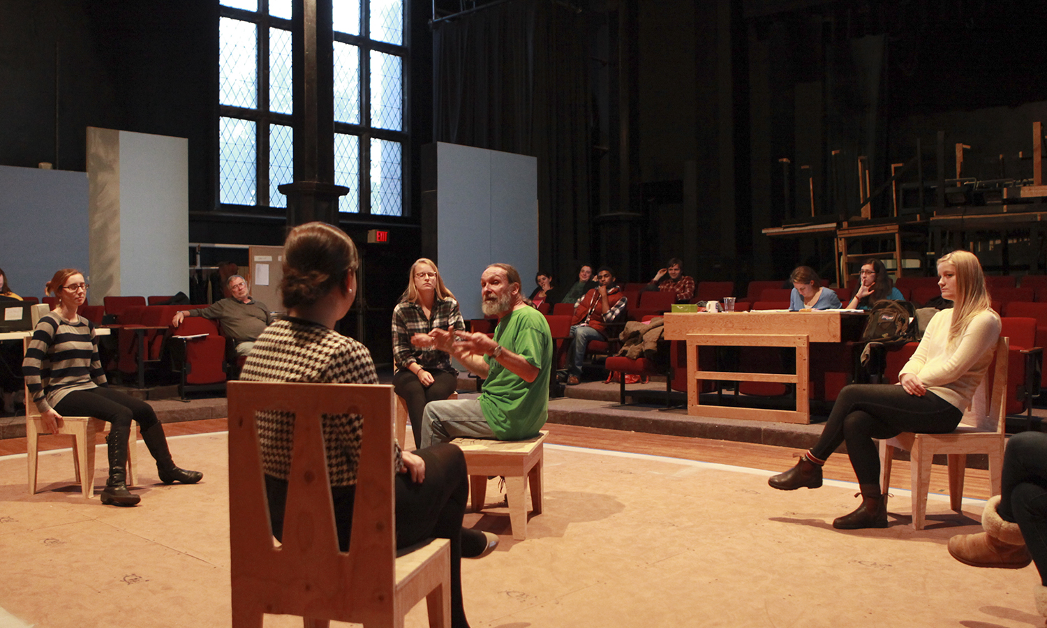 Professor of Education Pat Collins guides actors during a rehearsal of the upcoming play the Heidi Chronicles