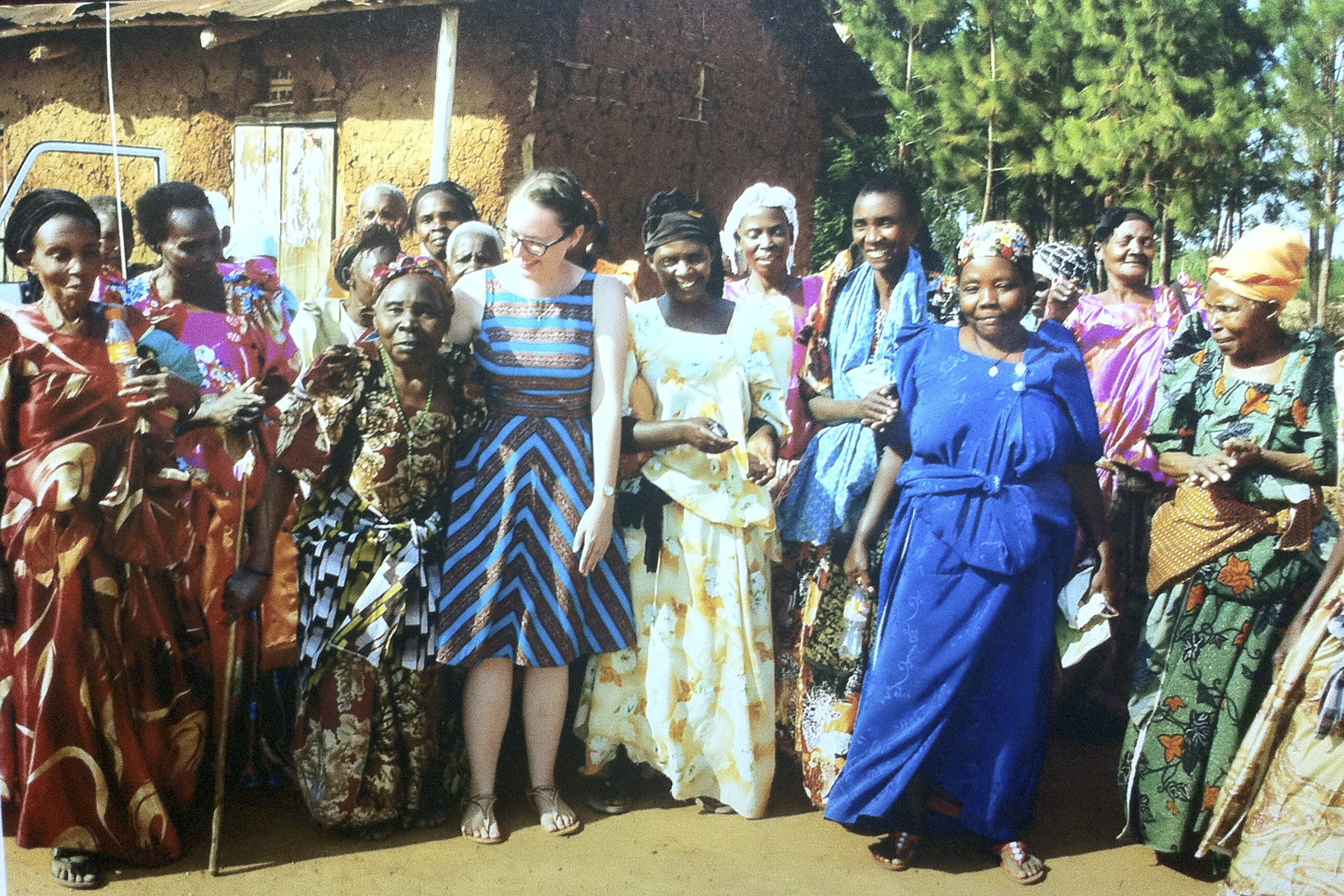 Janet Campâ 14 serves in Uganda. Here, she poses with elders in the community who she worked with through the Grandmothers' project.