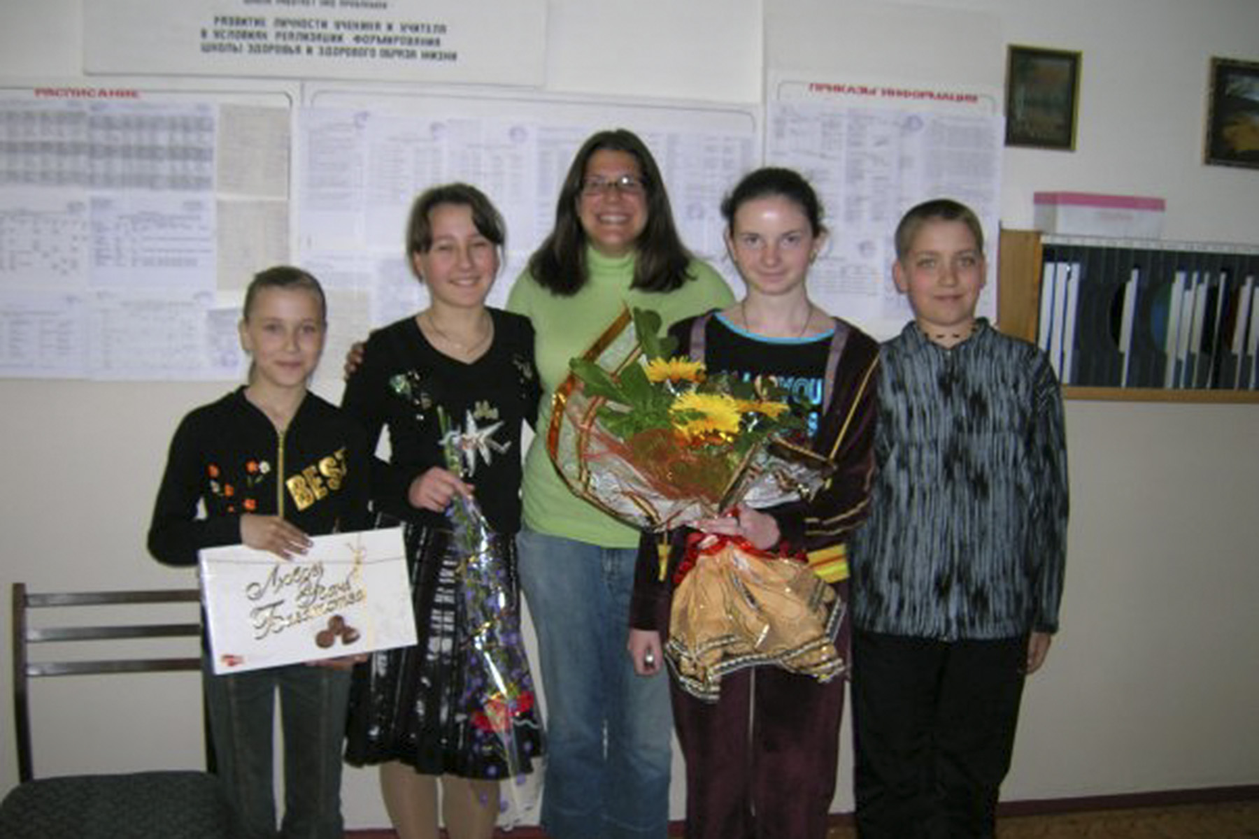 Jessy Teickenson â04 poses with her students in Armyansk, Crimea. Before her service in Ukraine from 2005 to 2007, Teickenson served in Uzbekistan.