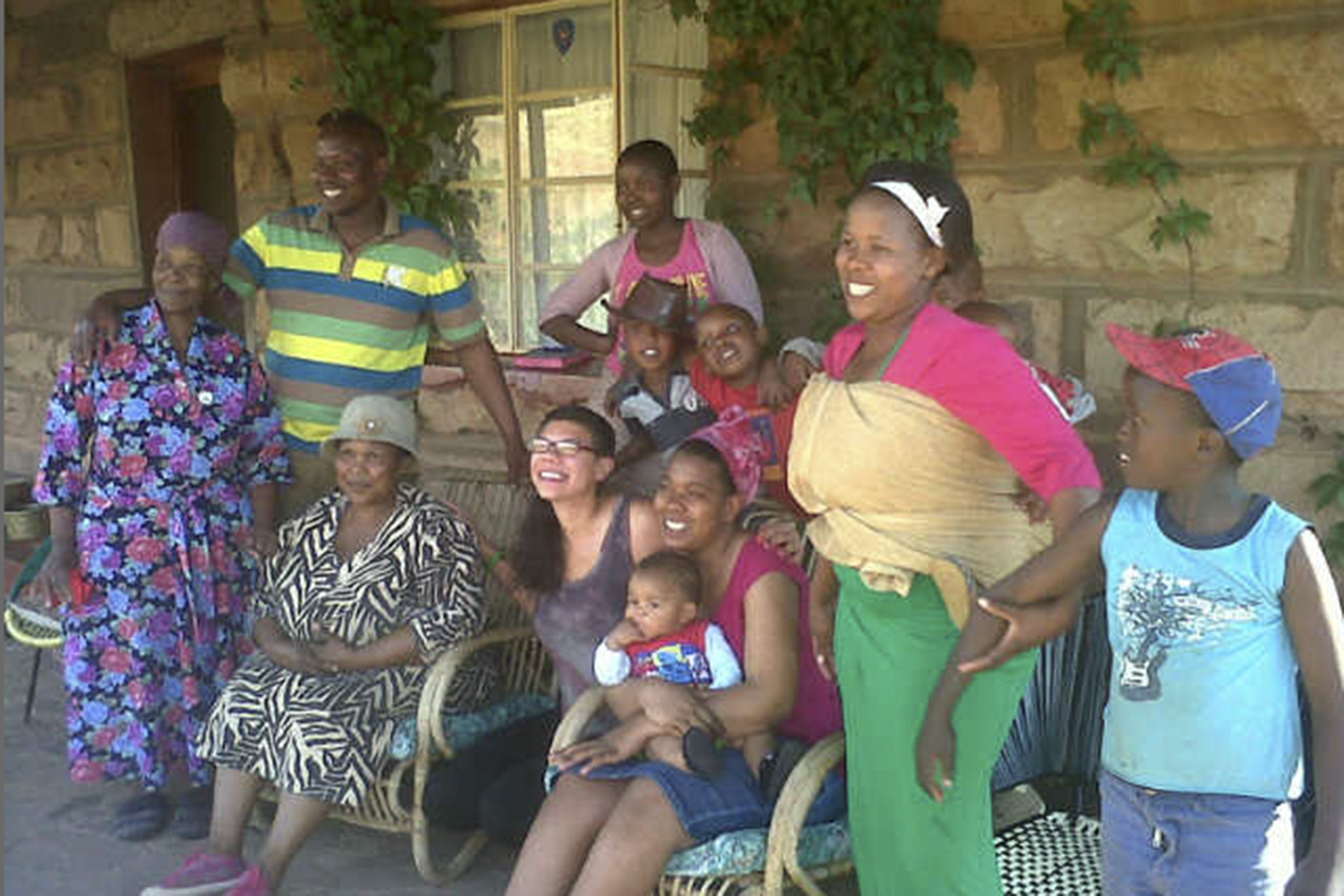 Shanelle France â11 sits with community members in Lesotho, where she served as a teacher intervention trainer.