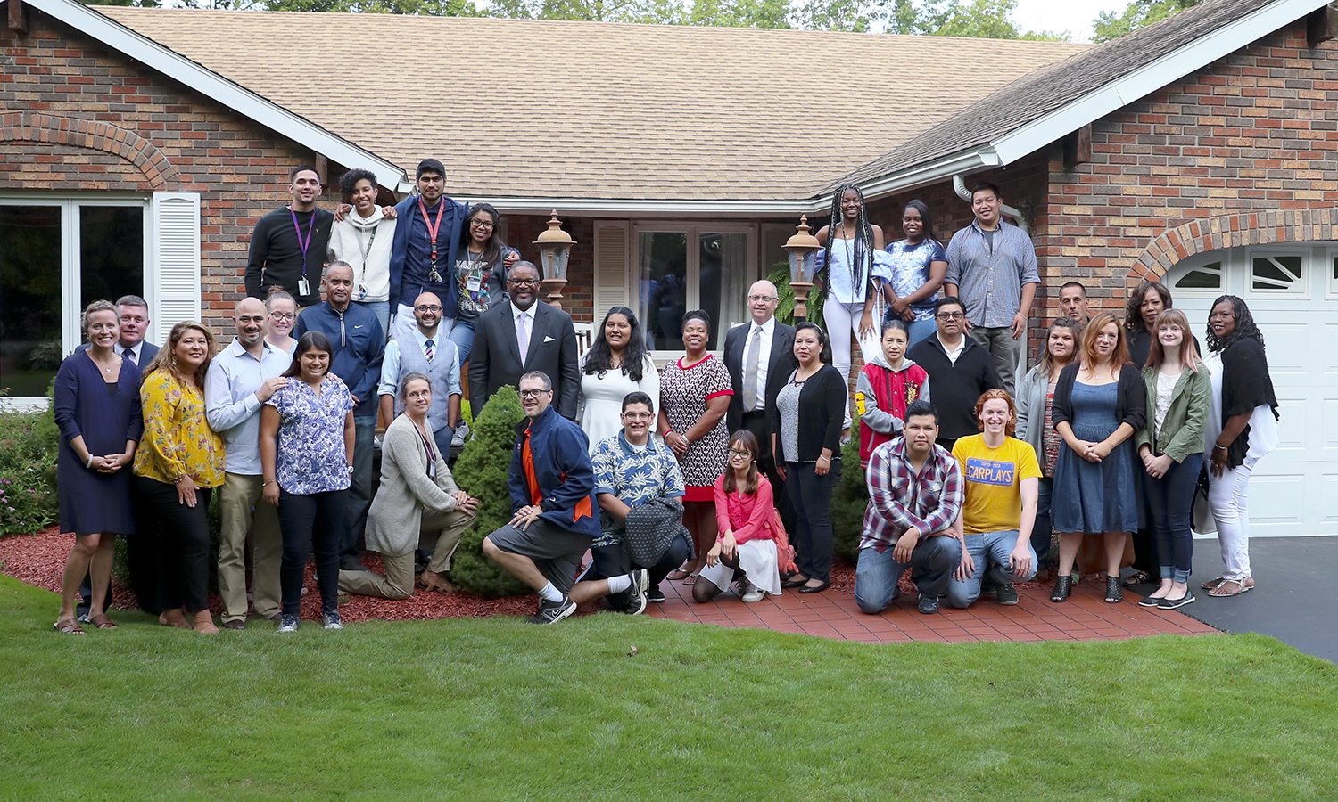 Members of the HWS Posse 5 cohort gather for a group photo outside the home of Vice President for Student Affairs Robb Flowers and Director of the Center for Community Engagement and Service Learning Katie Flowers