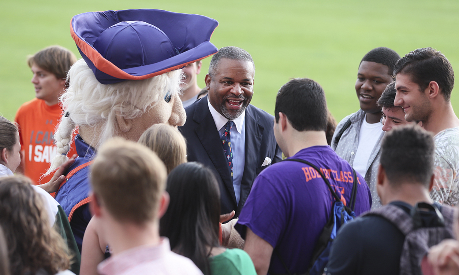 HWS President Gregory J. Vincent '83 greets students outside Coxe Hall during his first day in office.
