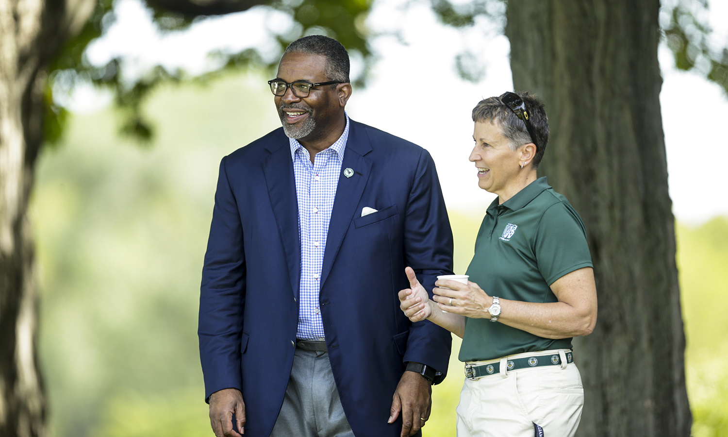 President Gregory J. Vincent '83 chats with William Smith Athletic Director Deb Steward during a William Smith Soccer scrimmage.