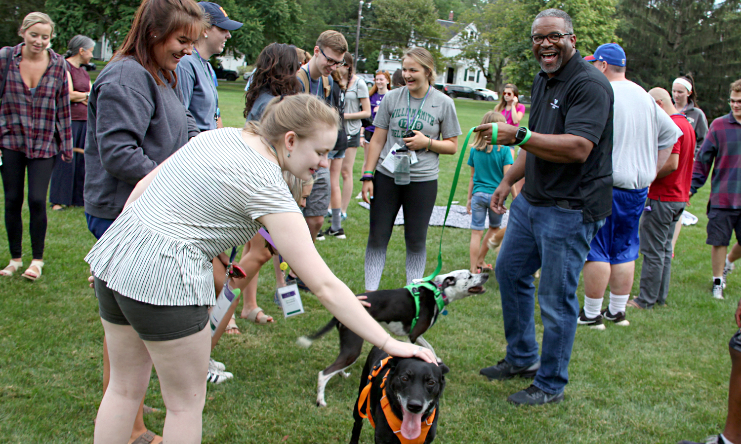"During ""Paws for a Break"" on Smith Lawn, students President Gregory J. Vincent's '83 dogs meet ""Scout"" and ""Rex."""