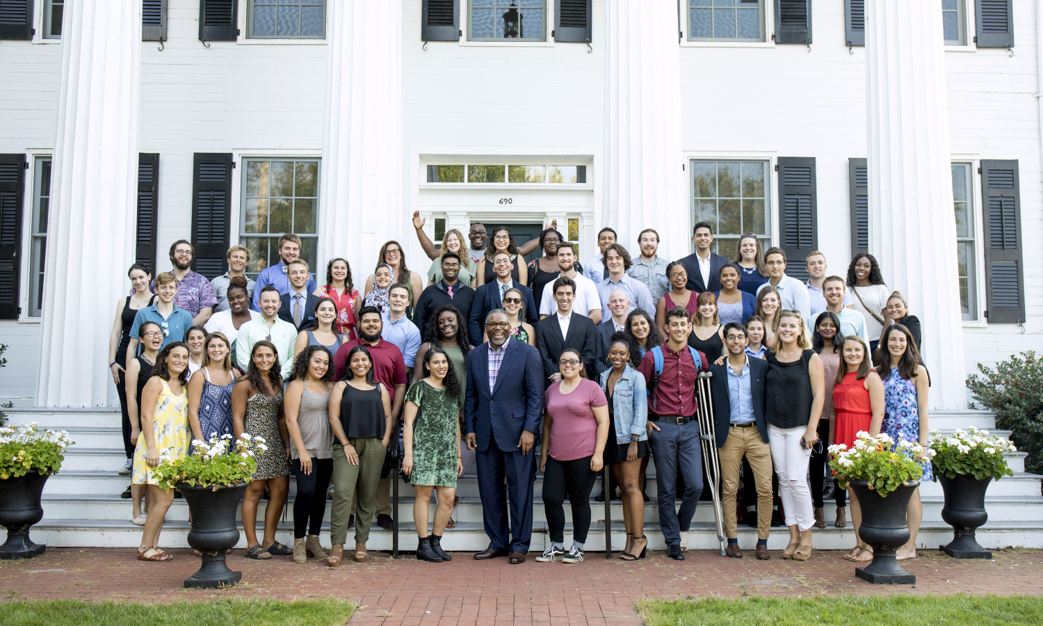 President Gregory J. Vincent '83 joins the Residential Education staff and resident assistants for a group photo on the steps of the President's House after the annual Resident Assistant Welcome Dinner.