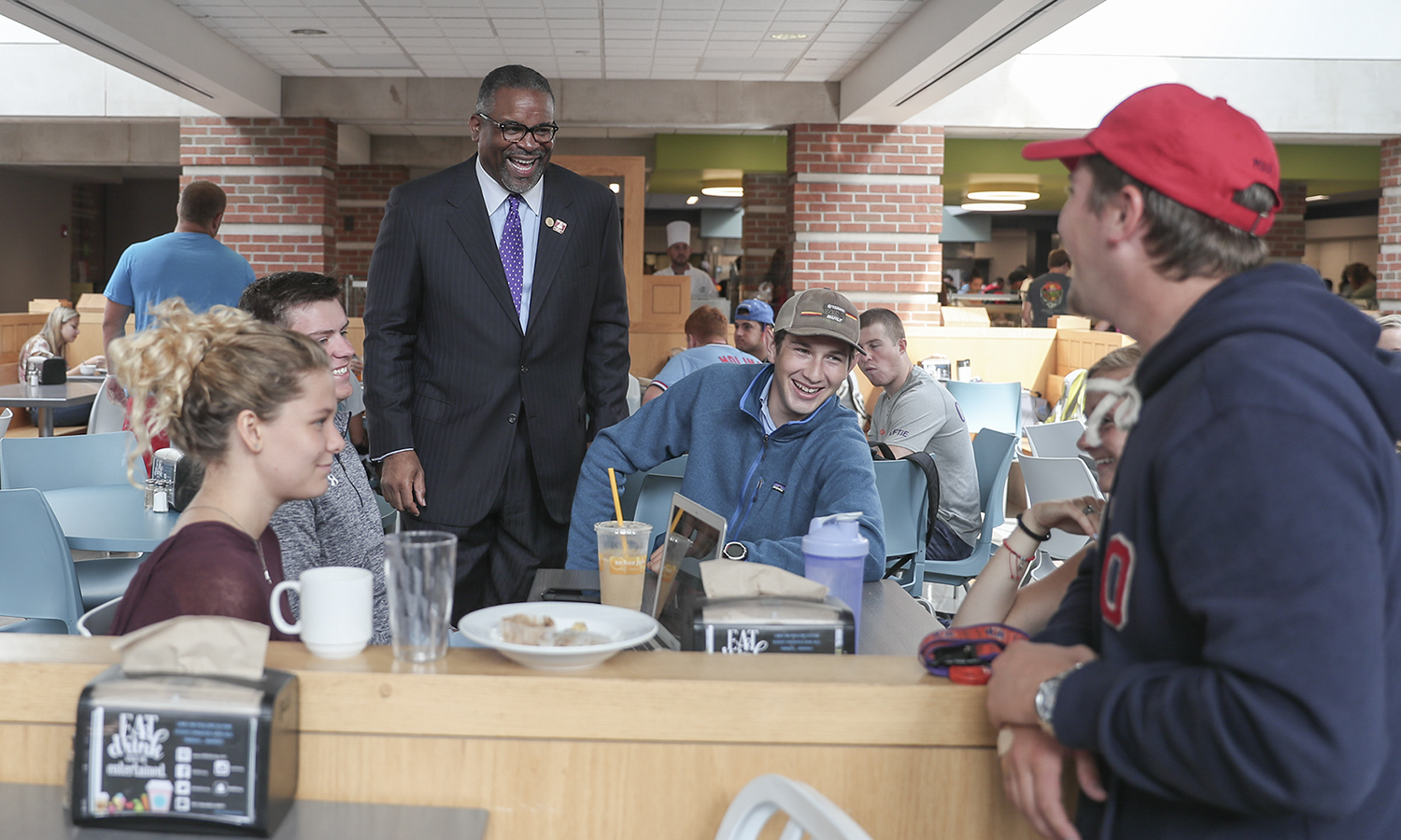 President Gregory J. Vincent '83 talks with students in Saga dining Hall on Monday.
