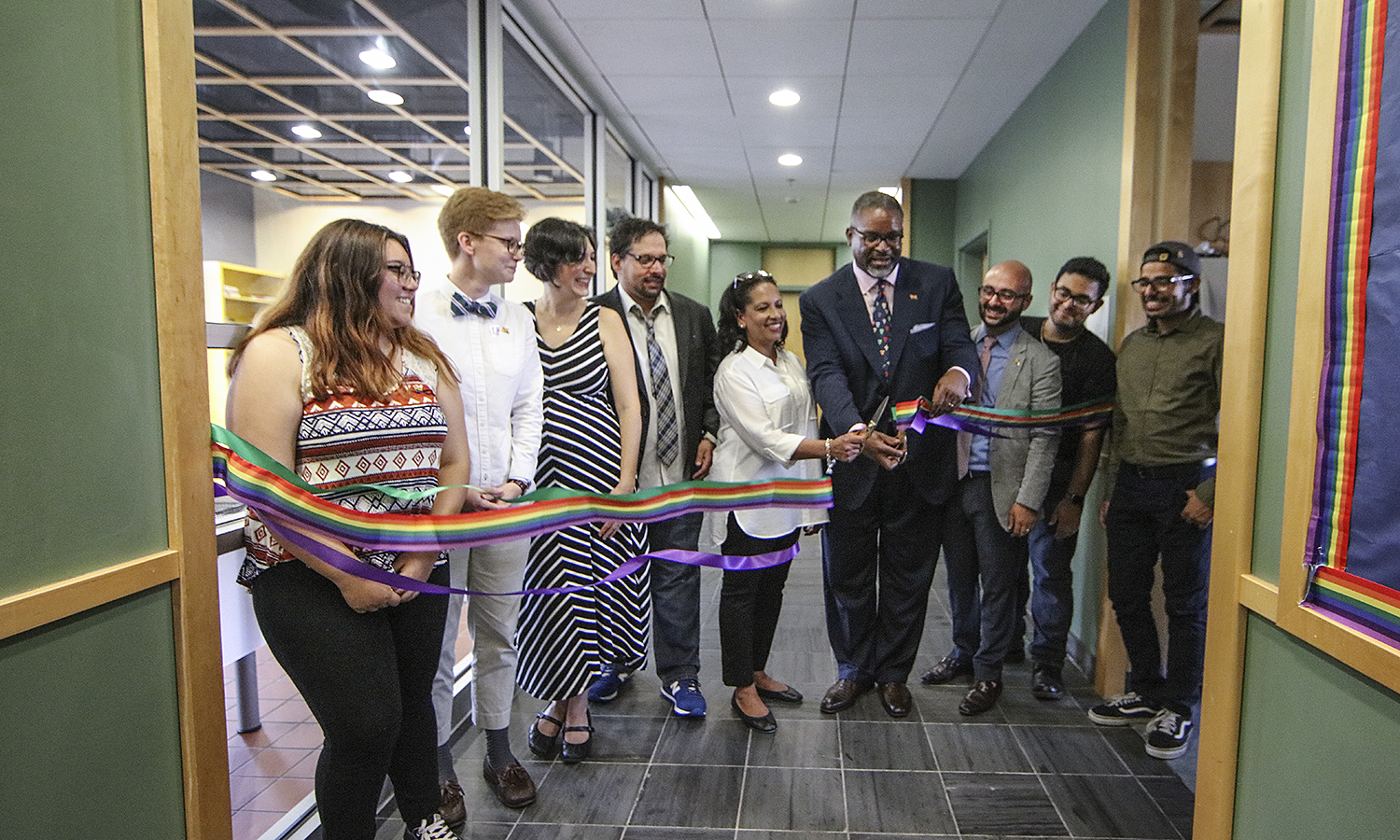 Kim Wilson Vincent and President Gregory J. Vincent '83 cut the ribbon of the Colleges' new LGBTQ+ Resource Center in de Cordova Hall. The new Center provides programming, education and outreach initiatives.