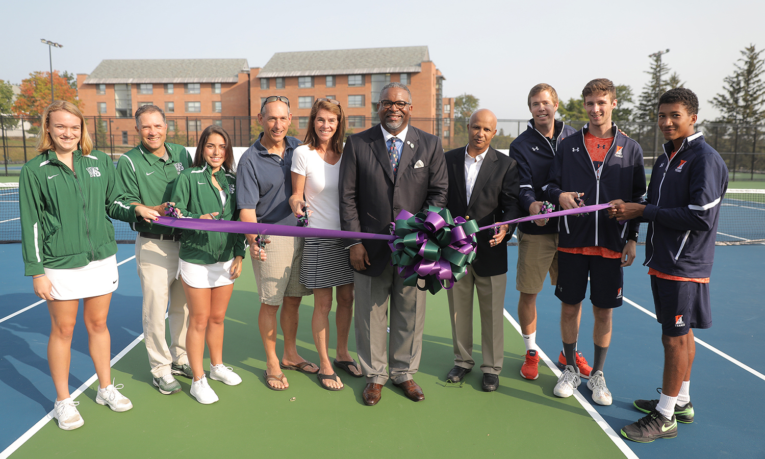 Members of the Hobart and William Smith tennis teams and their coaches join with Mark '86 and Karen Carpenter '88 Gray P'19, President Gregory J. Vincent '83 and James Atwater P'19 for an official ribbon cutting.