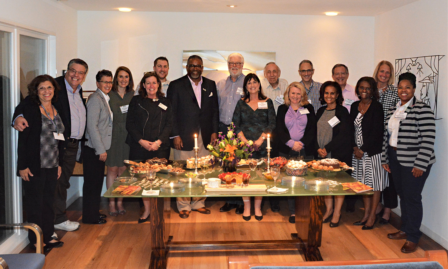 "HWS alums gather with President Gregory J. Vincent '83 (center) and Director of William Smith Athletics Deb Steward (third from left) during a special welcome event at the home of Trustee Dr. Richard L. '70 and Tina D. Wasserman in Dallas, Texas. Steward received the ""Administrator of the Year Award"" at the Women Leaders in College Sports National Convention earlier that day.​"