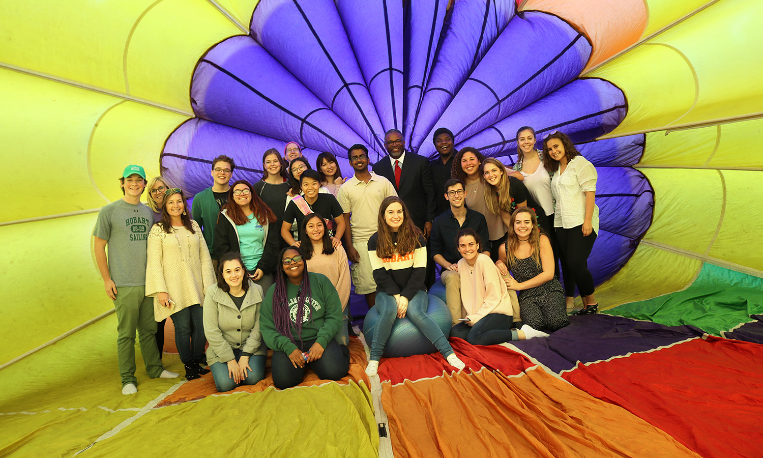 Students gather for a photo with President Gregory J. Vincent '83 inside a hot air balloon on the Quad.