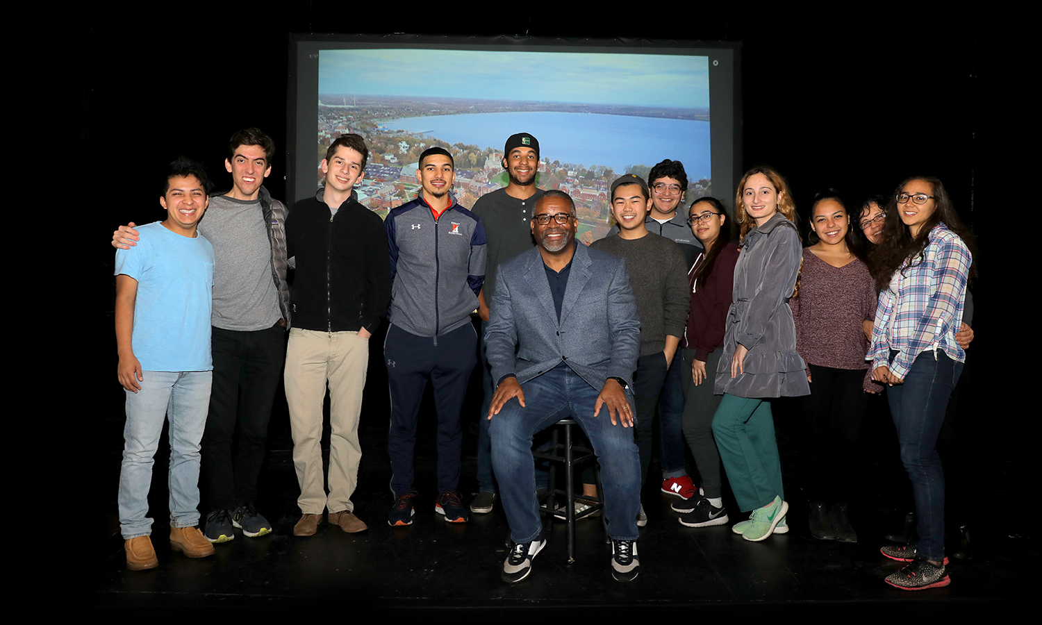 Students gather for a photo with President Gregory J. Vincent during Thanksgiving dinner in the Bartlett Theatre.
