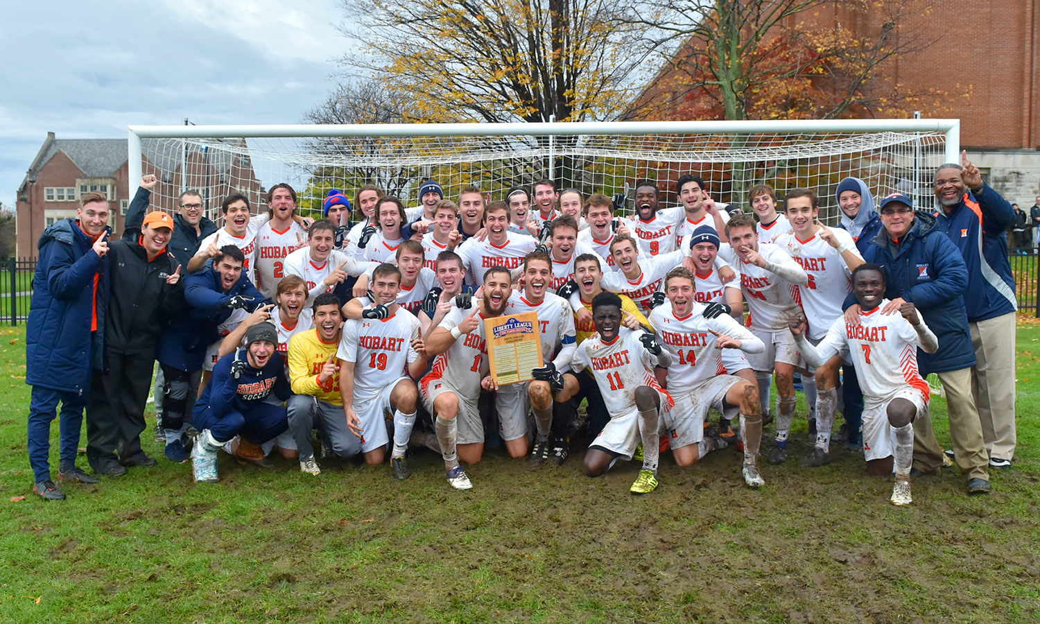 Joined by their coaches and President Gregory J. Vincent '83, the Hobart soccer team gathers for a celebration photo after capturing the 2017 Liberty League Men's Soccer Championship title.