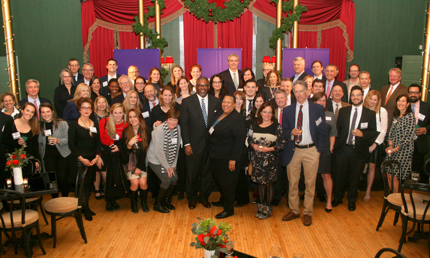 Alums and friends of the Colleges gather for a group photo  with President Gregory J. Vincent during the annual HWS holiday gathering at X in Chicago, IL.