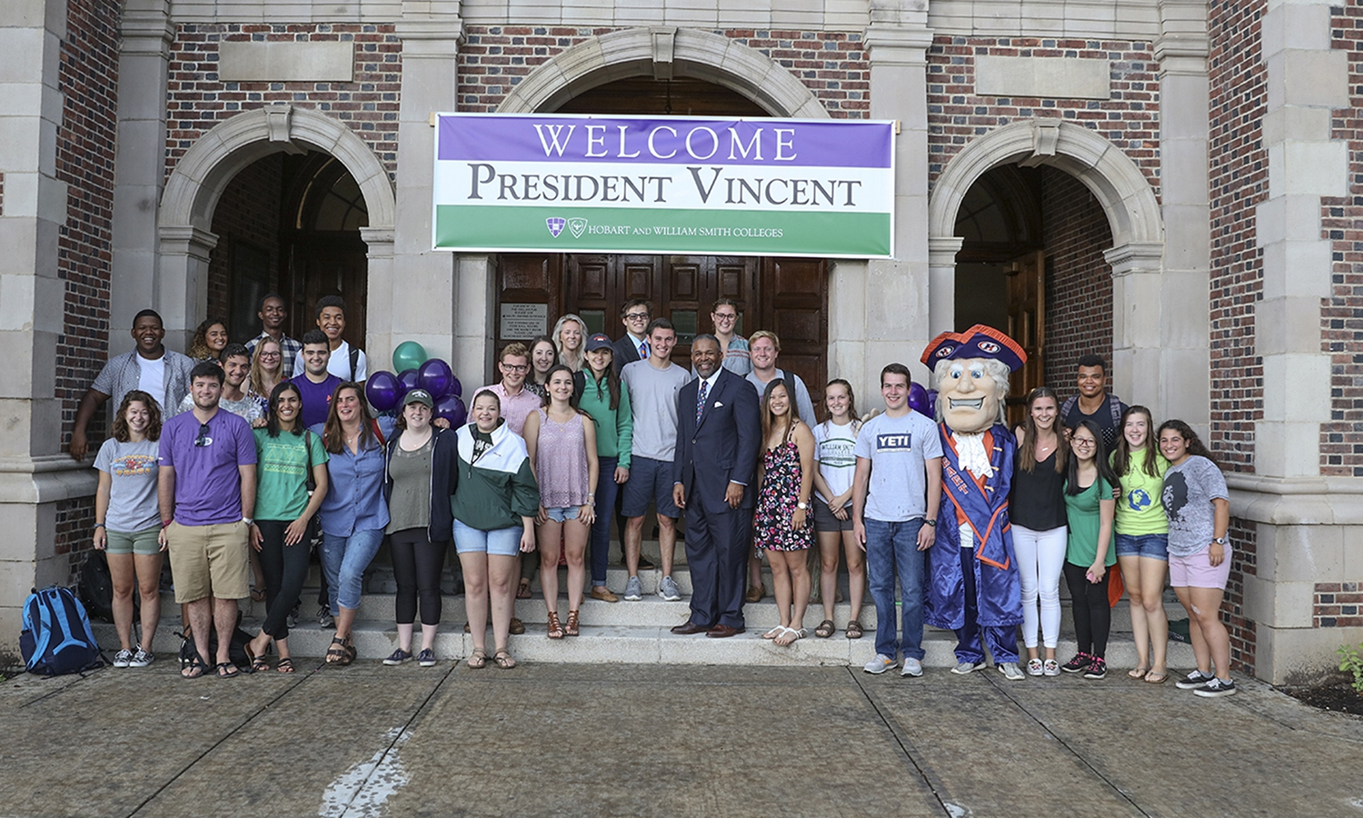 HWS President Gregory J. Vincent â83 gathers with students for a photo in front of Coxe Hall during his welcome to campus.
