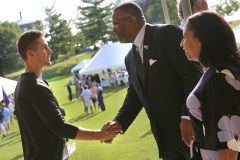 President Gregory J. VIncent '83 and Kim Wilson Vincent greet students on the steps of Coxe Hall.