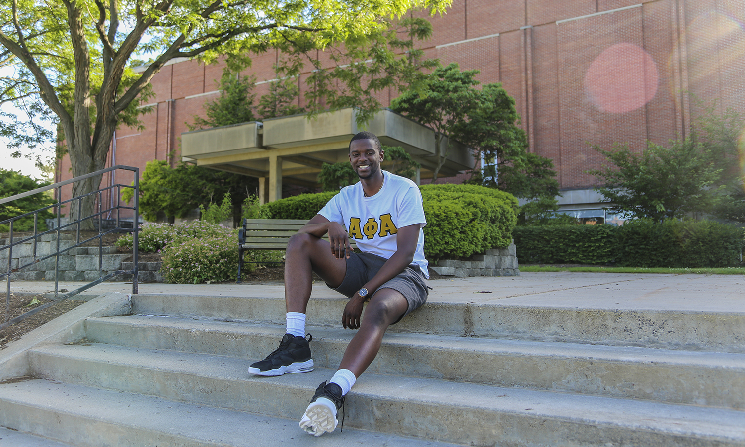 Edens Fleurizard, Student Trustee and Varisty Hobart Basketball player, relaxes outside Bristol Gymnasium. Bristol Gym is his favourite place on campus because of the great times that he has had with his teammates on and off the court. Edens is on campus this summer doing working in the Office of Admissions as a tour guide.