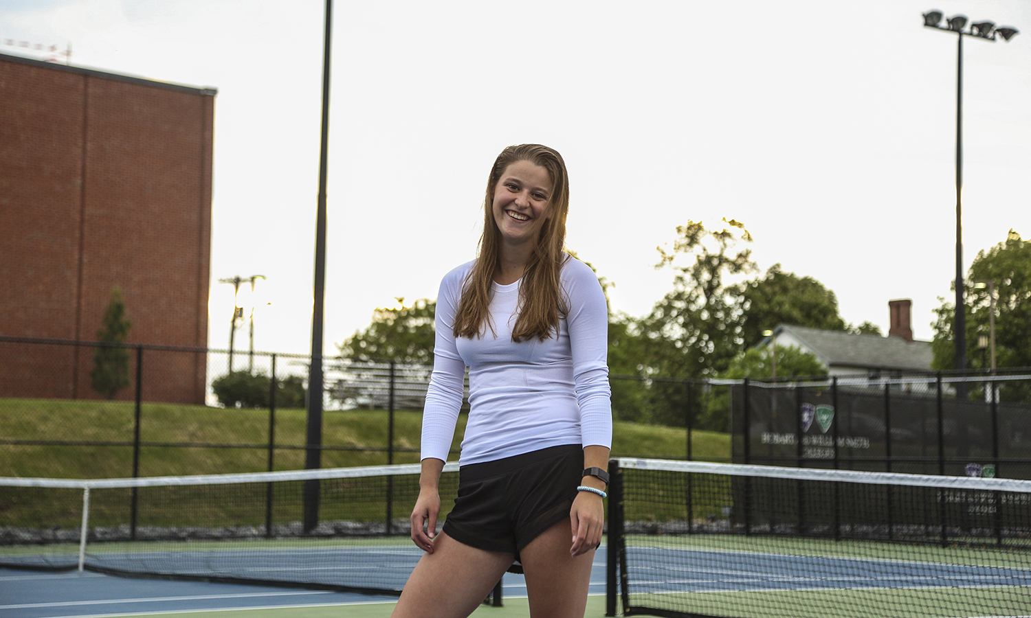 "Sophomore Kate Foley is pictured on the Marrow Championship Court saying, ""Tennis was the one thing I knew as a first year, and it gave me an escape when school became overwhelming."" Kate is on campus this summer doing biology research with Professor Susan Cushman in the Biology Department."
