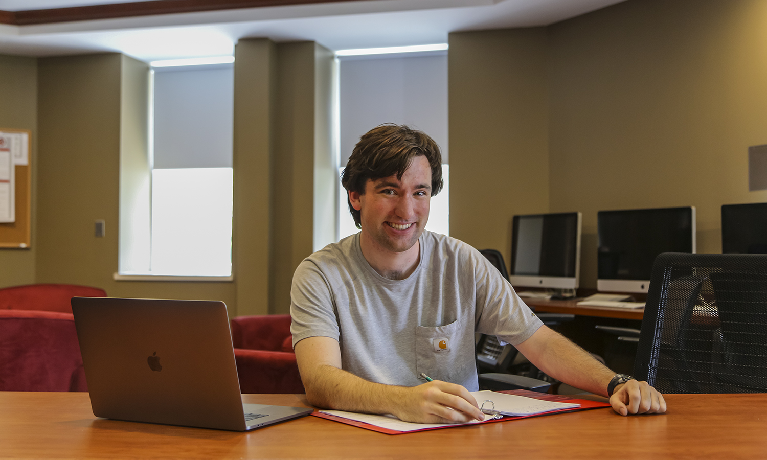 "Hugh Nick Mckenny, a Mathematics and Cognative Linguistics Double Major in the Teacher Education Program, sits in his favourite study spot, the basement of Merritt Hall. ""Merritt Hall is my favorite place because of the friendliness and availablility of the Education Department who are always willing to share thier kowledge and offer guidance."" Nick is on campus doing summer mathematics reasearch with the REU Summer Research Groups."