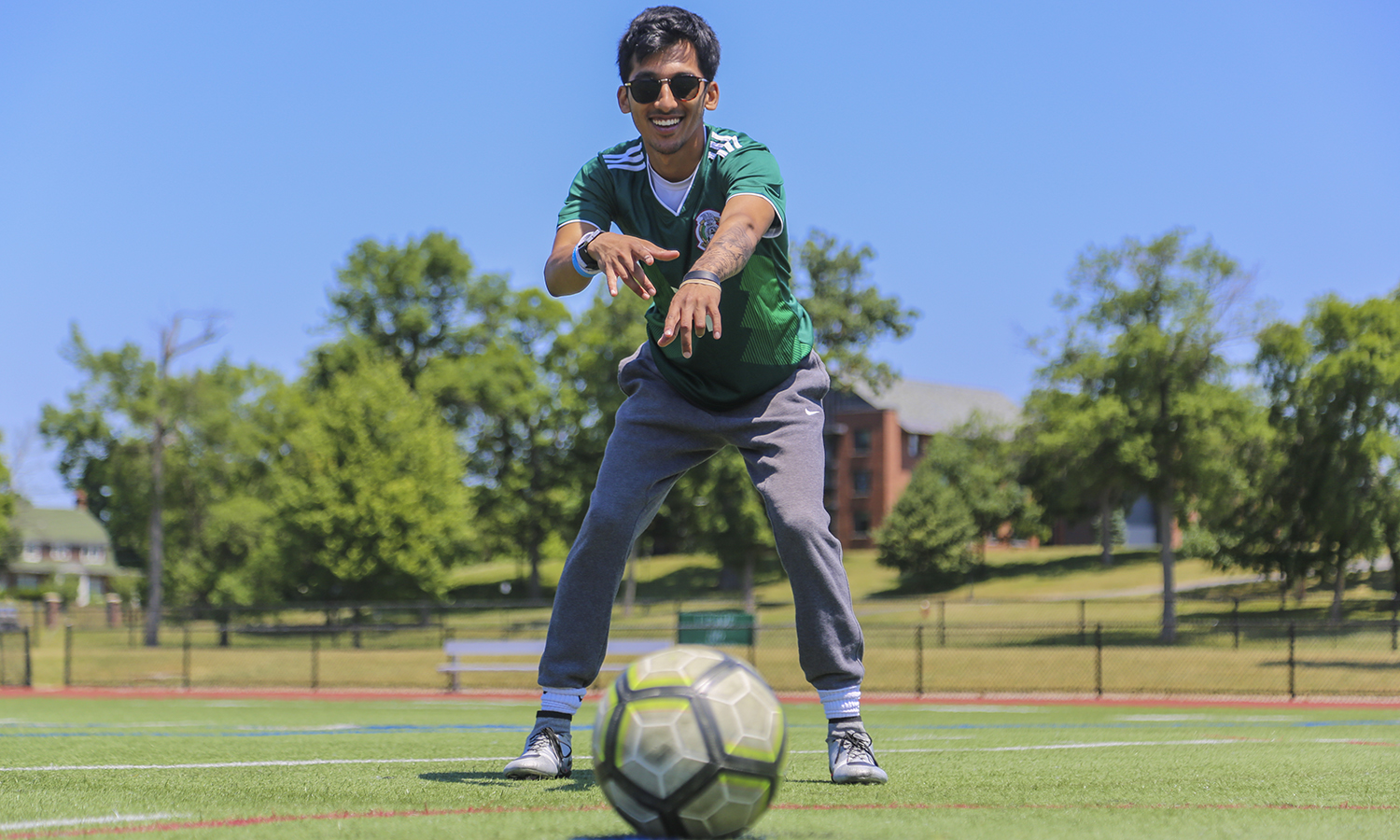 Dhiraj Mukkamala '20 stands on his favourite place on campus, Boswell Field. A team captain and striker on Hobart Club Soccer, Dhiraj's favourite memories are of playing on this field with his friends and teammates. Dhiraj is working for the summer in the HWS Communications office as a student photographer.