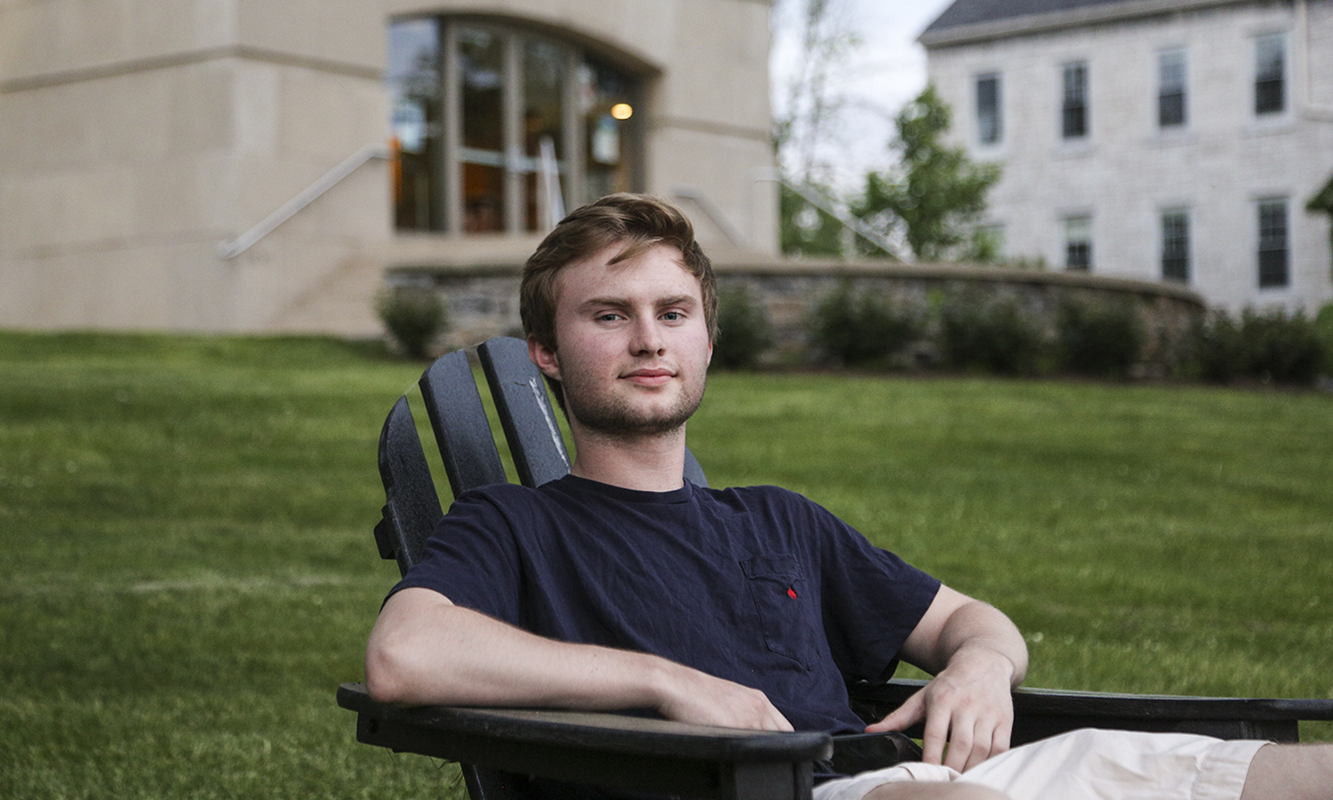 "Nate Ruffle-Deigenan '20 sits overlooking the Quad. He prefers these chairs because ""especially in the fall and spring it is the best place to be alone with your thoughts and chill."" Nate is on campus this summer doing research with Professor Stennett in the Chemistry Department."