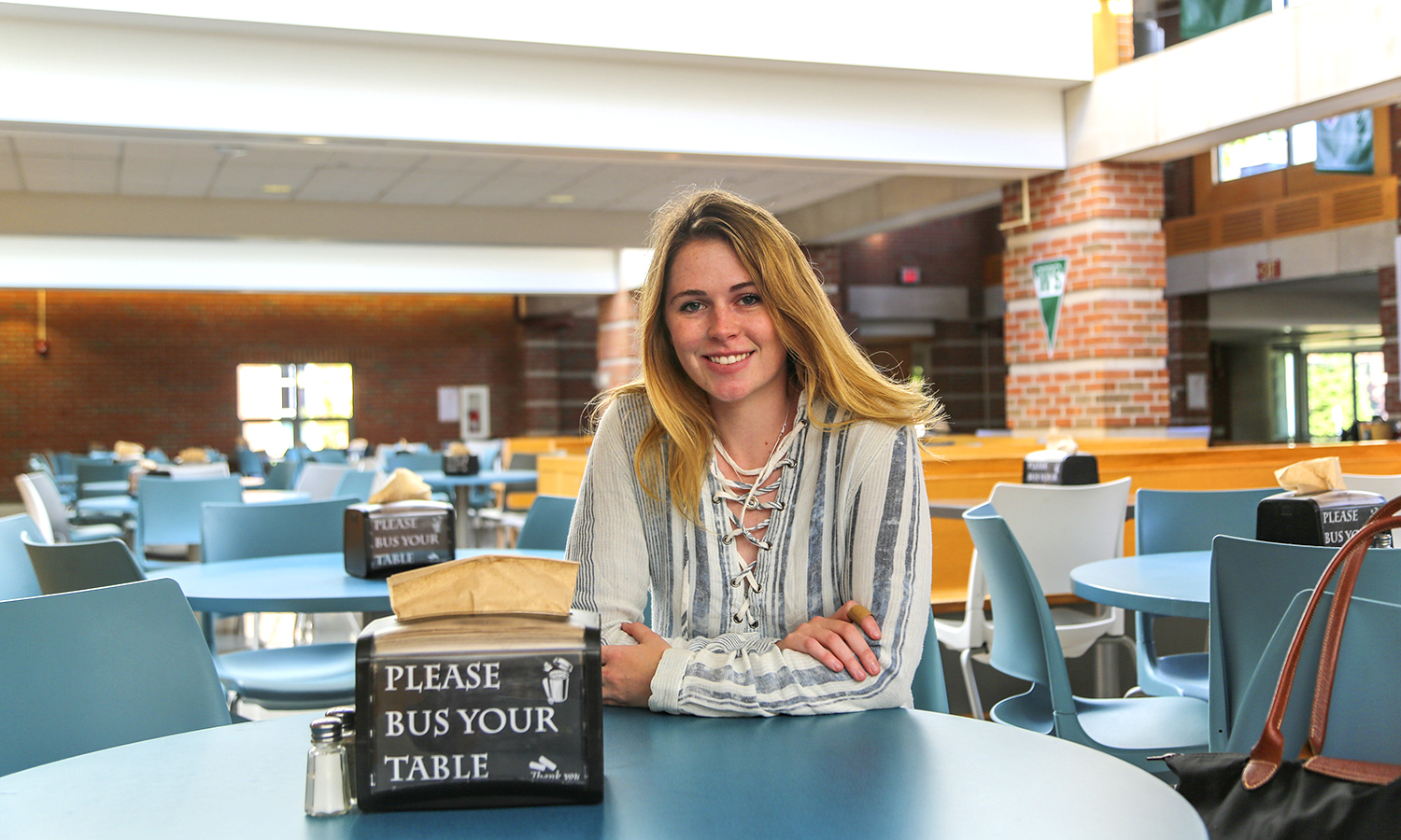 "Kaitlynn Sockett '20 is on campus doing summer research. Her favourite place on campus is Saga Dining Hall because she says, ""I get to hang out with friends while eating saga sauce drenched fries which is the best food on campus."""