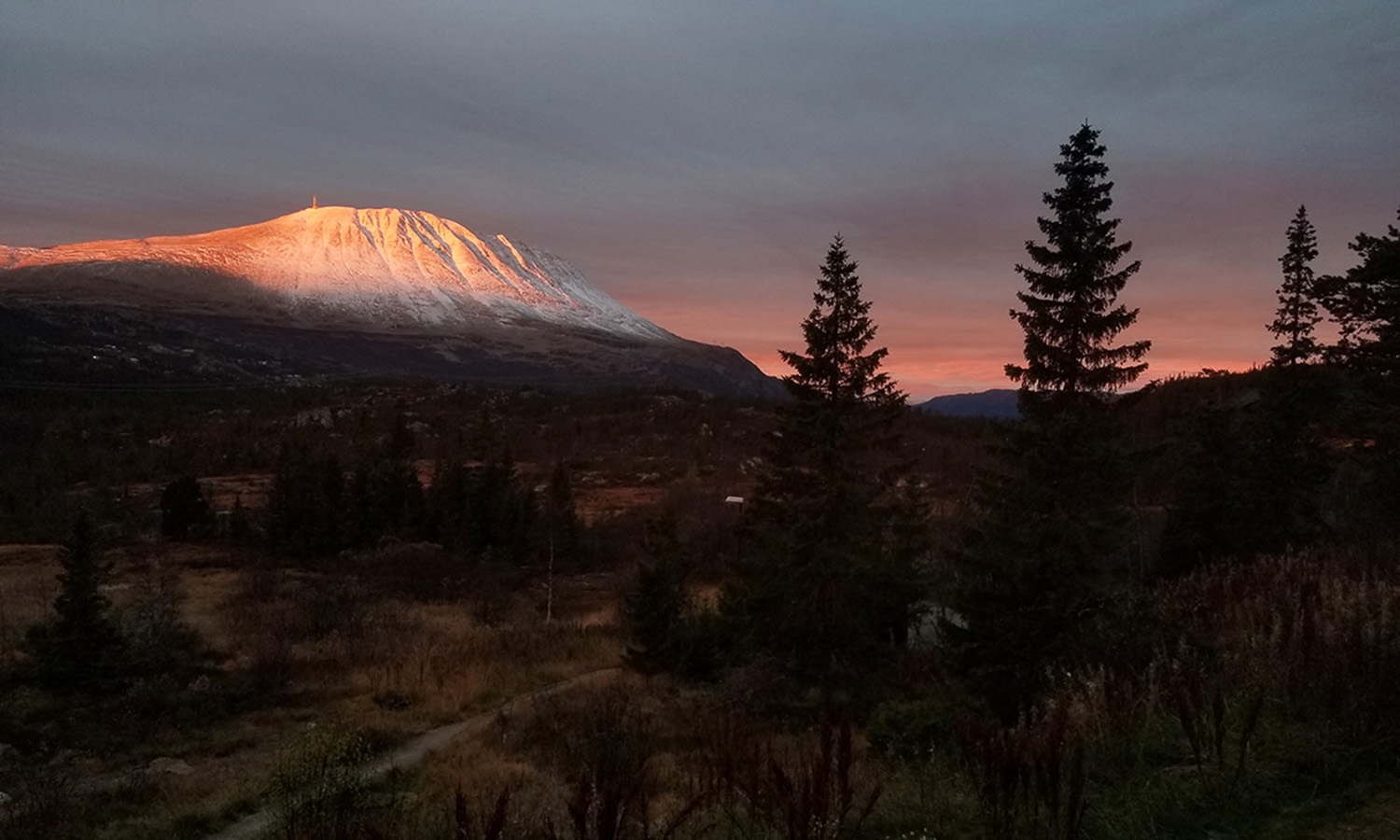 """Tied for first place in the """"Landscape"""" category in this year's study abroad photo contest, Kate Homet's â18 mountaintop sunset outside of Rjukan, Norway."""