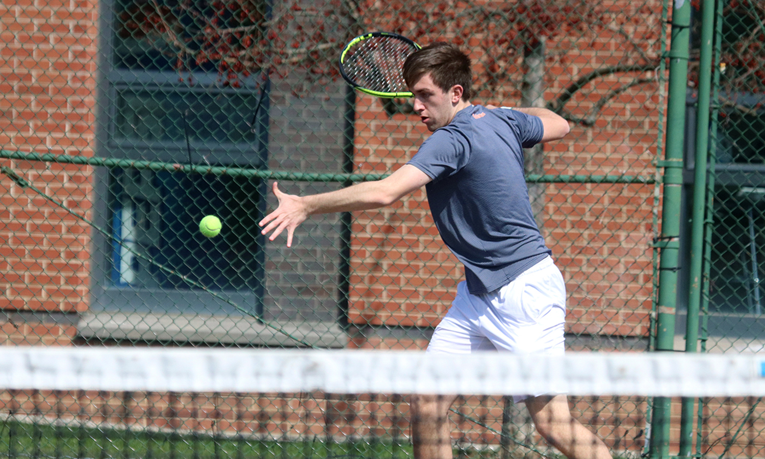 Alan Dubrovsky '20 lines up a forehand during Hobart's match against St. Lawrence University. Dubrovsky was voted the Liberty League Men's Tennis Rookie of the Year by the conference's coaches
